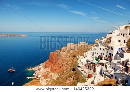 Day panorama of Oia Santorini with sea and caldera on background
