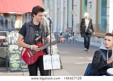 St. Petersburg, Russia-september 09,2016: The Street Musician Plays On The Street Of St. Petersburg.