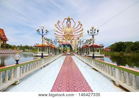 SURAT THANI, THAILAND - MAY 2015 : Giant Guanyin statue with multitude arms at Wat Plai Laem temple on Koh Samui, Surat Thani in Thailand on May 29, 2015. Guanyin is Goddess of Mercy and Compassion