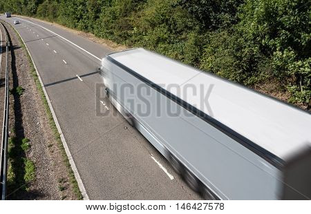 Grey lorry in motion on the motorway