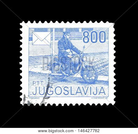YUGOSLAVIA - CIRCA 1988 : Cancelled postage stamp printed by Yugoslavia, that shows Postman on motorcycle.