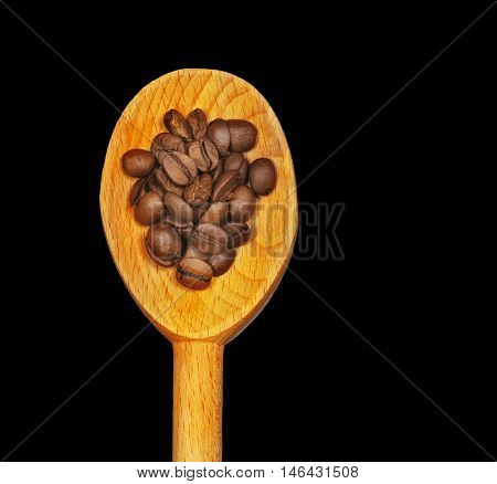 Nice Close up Image of Coffee Beans On Wooden spoon