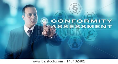 Seasoned male corporate manager pressing CONFORMITY ASSESSMENT via a virtual push button onscreen. Business and technology concept for inspection processes of the observance of technical standards.
