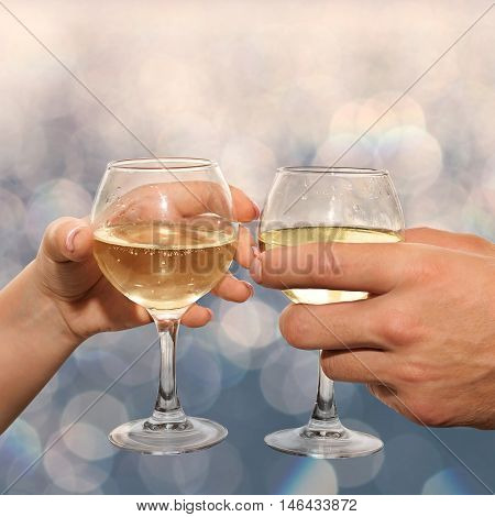 Couple Hold Glasses Of Champagne