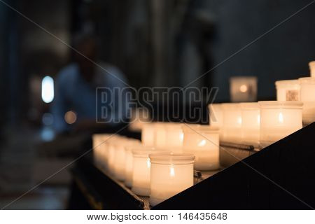 Glowing Candels Inside The Trento Cathetral