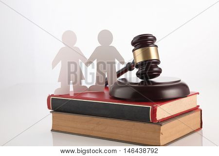 gavel hammer and people link on stack of books