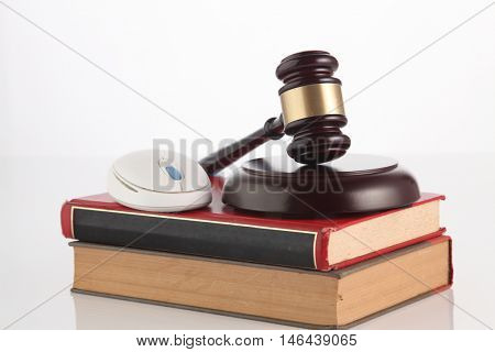 gavel hammer and cordless mouse on the white background