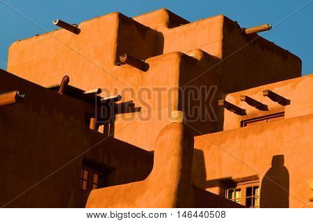 Historic adobe style building taken after a rain shower in Santa Fe, NM