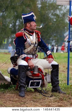 BORODINO MOSCOW REGION - SEPTEMBER 04 2016: Reenactor dressed as Napoleonic war soldier at Borodino battle historical reenactment in Russia. Color photo.