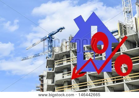Red percent sign on the background of building a house . The concept of price changes on the real estate market .