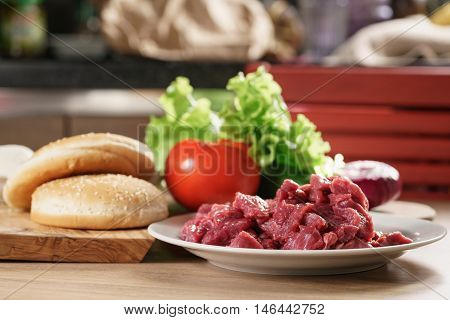 ingredients for burger on kitchen table, homemade food