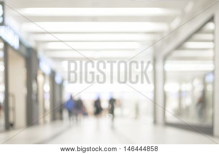 Blur store with bokeh background. Silhouettes of People in Blurred Motion Walking. Business people walking in the office corridor.