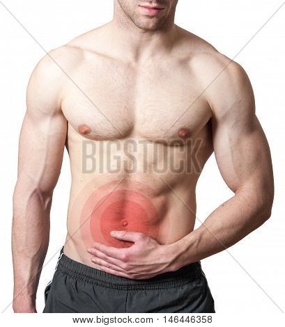 Muscular shirtless young man with stomach pain