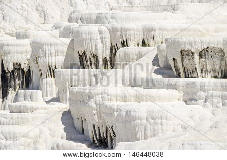 Stalactites of Pamukkale's terraces made of travertine a sedimentary rock deposited by water from the hot springs.