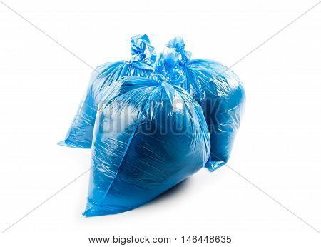 Three blue garbage bags isolated on white background