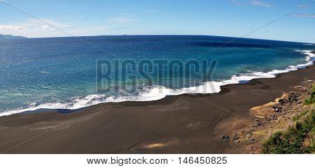 Long Stretch Of Black Sand Beach