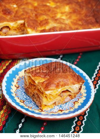 Italian lasagna with ham and cheese. Vertical shot