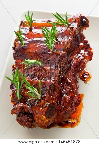 Slow cooked pork ribs with rosemary. Vertical shot