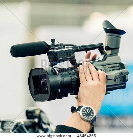 Cameraman working detail from press conference, color image