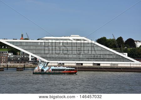 HAMBURG, GERMANY - AUG 27: The Dockland Office Building in Hamburg, Germany, as seen on Aug 27, 2016. The site is a protruding spit of land used as a dock until 2004 for the ferry terminal to England.
