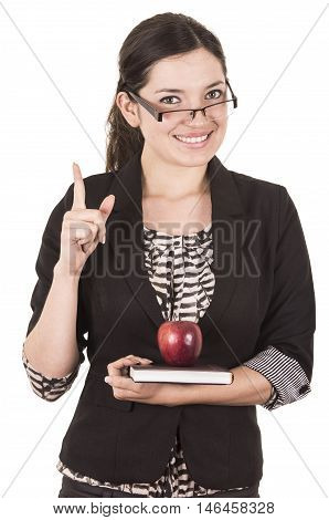 sweet female teacher holding red apple holding finger up isolated on white