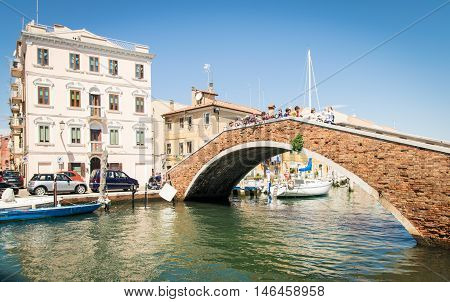 Chioggia italy - May 20 2016: Typical bridge across a canal in Chioggia Venetian Lagoon Italy.