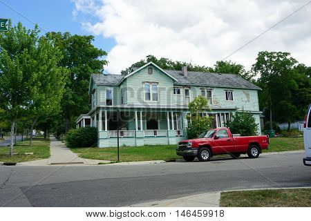 PETOSKEY, MICHIGAN / UNITED STATES - AUGUST 5, 2016: A large Victorian home at the corner of Mitchell and Division Streets near downtown Petoskey.