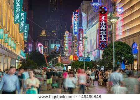 Shanghai China - July 19 2016: Neon signs lit on Nanjing Road. The area is the main shopping district in Shanghai city and one of the world's busiest shopping streets in Shanghai China.