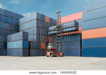 Crane lift up container box loading to cargo caontainer depot use for logistics import export.