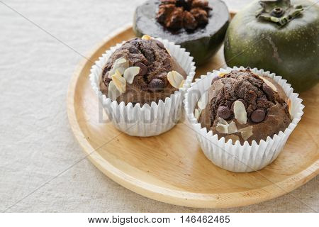 Homemade Cupcakes Made From Black Sapote Chocolate Pudding Fruit In Wooden Plate