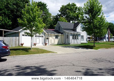 PETOSKEY, MICHIGAN / UNITED STATES - AUGUST 5, 2016: A home with an attached two-car garage near downtown Petoskey.
