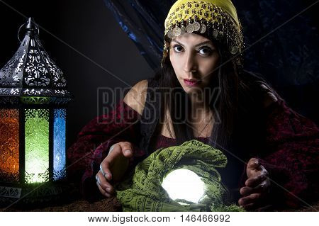 Woman dressed in a Halloween costume as a fortune teller gypsy