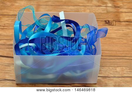 A mixture of blue ribbons in a box