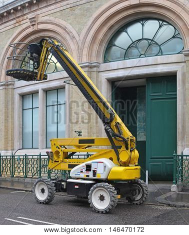 Yellow Articulated Boom Lift for Construction Work