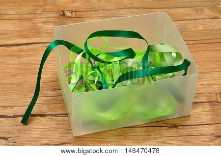 A mixture of green ribbons in a box