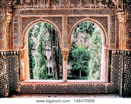 moorish window with arches looking into courtyard
