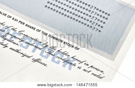 Close up of a stock certificate representing shares in a company