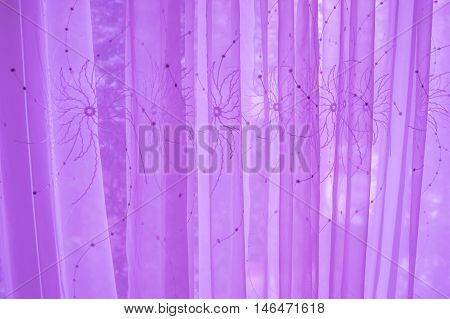 Dreamy purple curtain with a open window