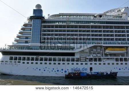 HAMBURG, GERMANY - AUG 27: AIDAprima cruise ship docked in Hamburg, Germany, as seen on Aug 27, 2016. The ship was christened on 7 May 2016 in Hamburg, as part of 827th Hamburg Port Anniversary.