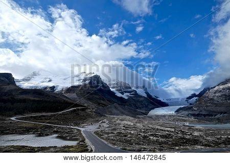 Mountains and glacier. Columbia Icefield. Rocky Mountains of North America. Canadian Rockies. Banff and Jasper National Park.