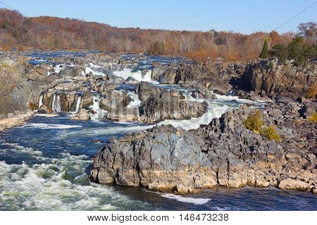 Potomac River waterfalls panorama in Great Falls state park in Virginia USA. Sunny autumn morning in the state park near the waterfalls.