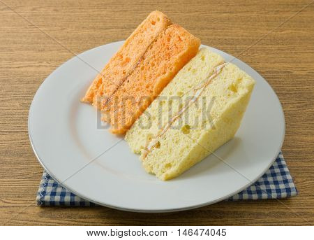 Snack and Dessert Vanilla and Orange Chiffon Cake Made With Butter Eggs Sugar Flour Baking Powder and Flavorings on A Dish.