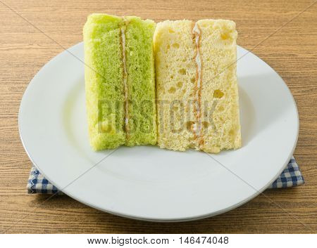 Snack and Dessert Pandan and Vanilla Chiffon Cake Made With Butter Eggs Sugar Flour Baking Powder and Flavorings on A White Dish.