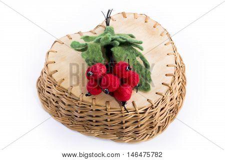 Brooch made of felt wool in the wicker basket