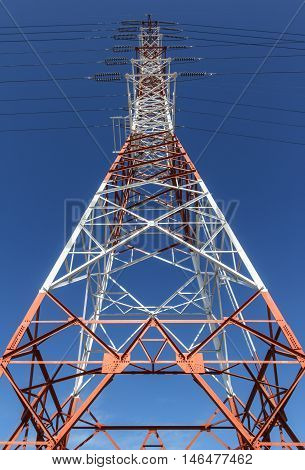 Power transmission lines against blue sky, outdoor