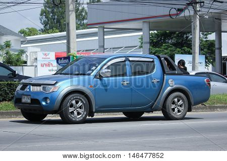 CHIANGMAI THAILAND -AUGUST 10 2016: Private car Mitsubishi Triton Pickup Truck. On road no.1001 8 km from Chiangmai Business Area.