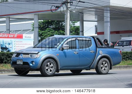 CHIANGMAI, THAILAND - AUGUST 10, 2016: Private car Mitsubishi Triton Pickup Truck. On road no.1001 8 km from Chiangmai Business Area.