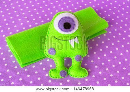 Green felt monster. Funny felt monster. Soft children toy
