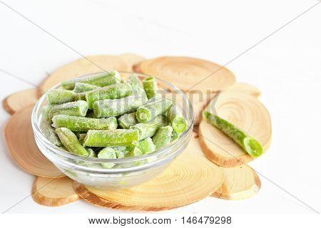 Frozen green beans in a glass bowl