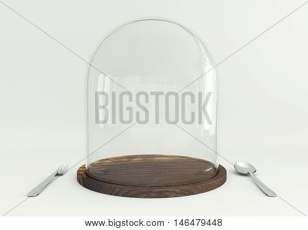 Glass dome on wooden tray with spoon and fork on white table background